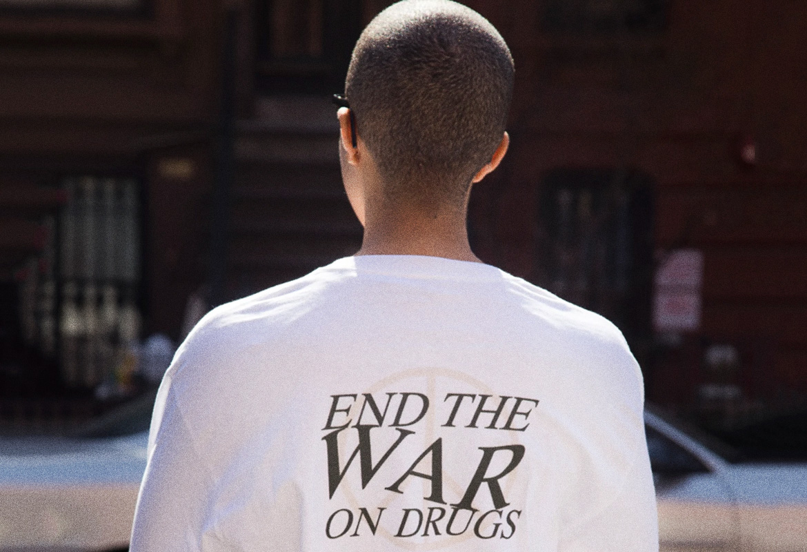"Guys back with white shirt that reads ""end the war on drugs"""